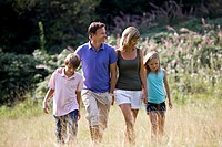 A family walking through a field, close_up
