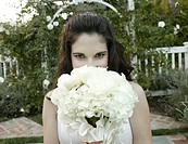 Portrait of a bride holding flower bouquet.