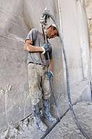 Italy, Tuscany, Apuan Alps. Man working in Cave del Passo della Focolaccia, marble quarry