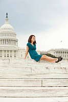 Girl on steps by united states capitol building