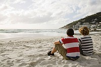Two boys sitting on beach