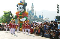 Giant Mickey Mouse float during parade, Fantasyland, Hong Kong Disneyland, Lantau Island, Hong Kong, China