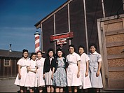 Japanese_American camp, Tule Lake Relocation Center, California 1942/1943. Eight Japanese women standing outside the barber's shop in the US war emerg...