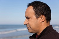 Mature man looking at the ocean, profile