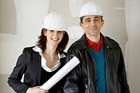 Architect and building contractor in hard hats, portrait