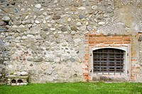 Stone wall with barred off window