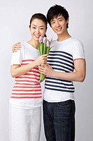 Young couple holding flower
