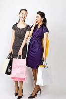 Young women holding shopping bags