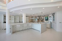 White modern kitchen with recessed lights