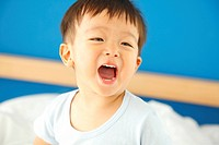Boy laughing with mouth open