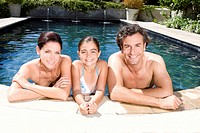 Portrait of a family in swimming pool