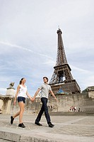 Couple walking in Paris close to Eiffel tower