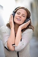 Woman hearing music