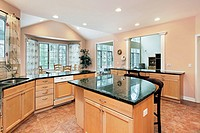 Kitchen in luxury home with marble top island