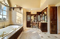 Master bath in new construction home with dark cabinetry