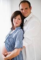 Young man hugging pregnant woman