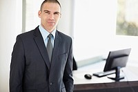 Portrait of businessman in office environment