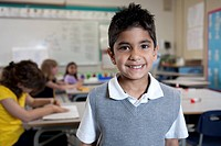 Indian boy smiling in classroom