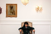 Vietnamese boy sitting on elegant chair