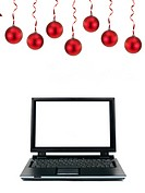 A laptop computer with christmas ornaments isolated against a white background