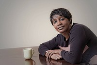 Black woman, age 44, with a cup of coffee