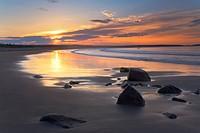Sunrise on a beach near the Port Bickerton Lighthouse, eastern shore of Nova Scotia