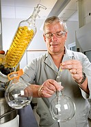 Plant nutrition research. Chemist evaluating the avenanthramide content of oat extracts. Oats are widely thought to have various health benefits for h...