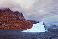 Iceberg and fjord mountains, Oeyer Fjord, Scoresby Sund, Greenland