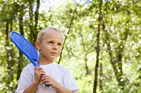 Little boy with a plastic racquet