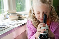 Girl looking in microscope (thumbnail)