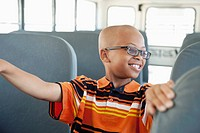 Boy riding school bus (thumbnail)