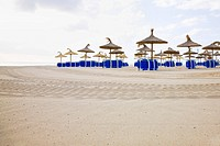 Beach umbrellas at beach on Mediterranean Coast