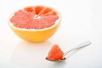 Half a grapefruit and a spoon
