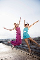 Young women jumping
