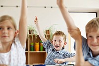 Children raising hands in classroom (thumbnail)