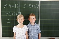 Children in front of blackboard
