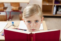 Girl reading book in school
