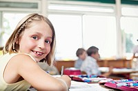 Girl smiling in classroom