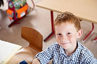 Boy at desk in classroom