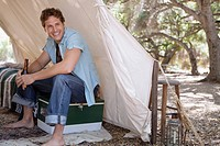 Man sitting in tent