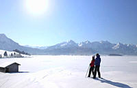 Mid adult couple skiing in Allgau,  Bavaria,  Germany