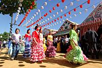 Abril, 20, 2010 Spain Seville April Fair. A crowd of people attend today the first real day of the 'feria de Abril' of Seville Many women dresses with...