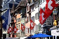 Zurich (Switzerland): street in the city's center with the Swiss flag, during Switzerland's national day (August 1st)