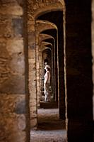A tourist walks inside the multiple arches inside the Santa Brigida, an abandoned gold mine, in Mineral de Pozos, San Luis de la Paz, Mexico  Mineral ...