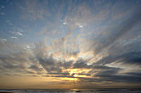 Dramatic clouds at sunrise over the Indian Ocean at Estuary Beach, St Lucia, Kwazulu Natal, South Africa