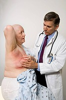 Doctor examining a cancer patient.