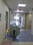 Housekeeping cart in a hospital corridor.