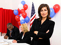 USA, Illinois, Metamora, Portrait of woman at polling place, US flag, balloons and voting booth in background