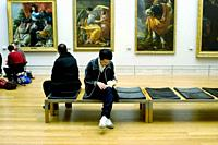 Paris, France, Interior French Paintings Gallery, Louvre Museum, young Asian Man Studying Book on Bench