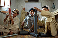 Afghan boys practice connecting pipes during a plumbing workshop at a rehabilitation centre for war_affected children in the Sara Jama neighborhood of...